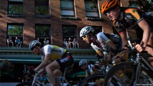 Spectators watch from windows during the women's race of the 40th annual Gastown Grand Prix bicycle race