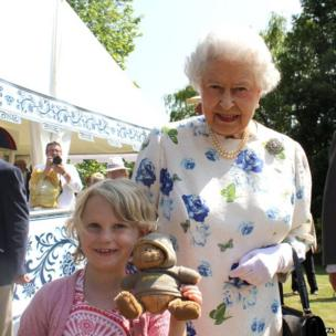 Seven-year-old Jessica Fitch, from Cheltenham, Gloucestershire, who got her wish at Buckingham Palace today when she asked the Queen to pose with her and her teddy bear,