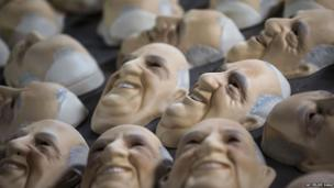 Masks in the likeness of Pope Francis dry at the Condal mask-making factory in Sao Goncalo, 9 July