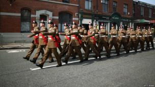 Members of The Royal Regiment of Fusiliers march through the high street for the funeral service
