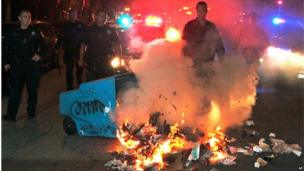 Oakland, California police put out a small fire set by protesters angered by Zimmerman's acquittal (14 July)