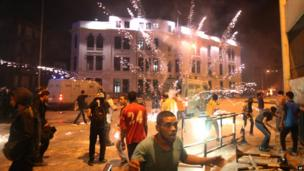 Opponents of ousted Egyptian President Mohammed Morsi run from fireworks fired by pro-Morsi supporters during clashes in Cairo