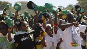 Supporters of Zimbabwean President Robert Mugabe greet him in Marondera, east of Harare