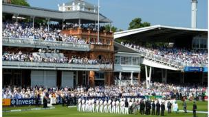 The cricketers lined the pitch at Lord's as crowds looked on