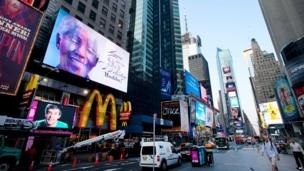 Image of Nelson Mandela on a Times Square billboard, New York City (18 July)