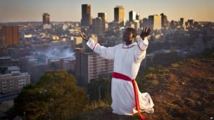 A man praying in Johannesburg, South Africa - Sunday 13 July 2013