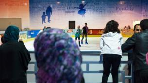 People watch skaters at Fun City