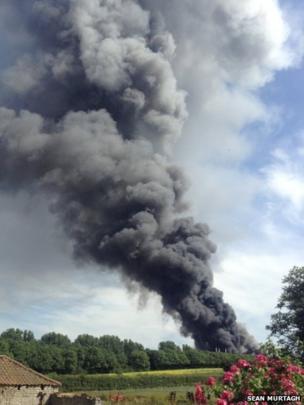 Grey smoke plumes into the sky. Photo: Sean Murtagh