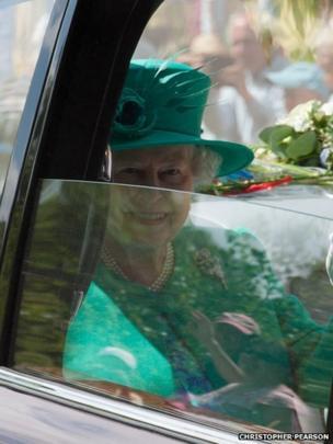 The Queen through a part open car window. Photo: Christopher Pearson