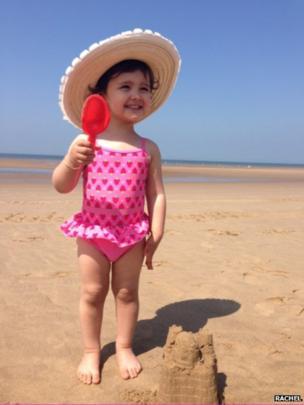 Jessica-Rose builds sandcastles. Photo: Rachel