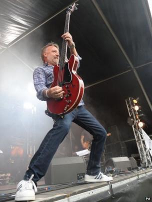Peter Hook plays guitar