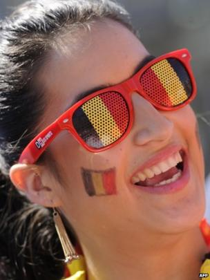 Well-wisher adorned in the colours of the Belgian flag on Belgian national day on 21 July 2013