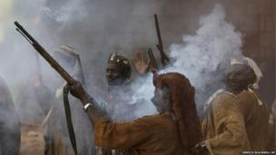 Dogon hunters fire shotguns