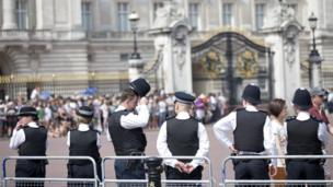 Police officers outside Buckingham Palace