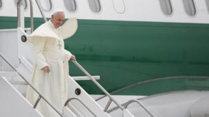 Pope Francis leaves the plane on arrival at the international airport in Rio de Janeiro, Brazil, 22 July, 2013