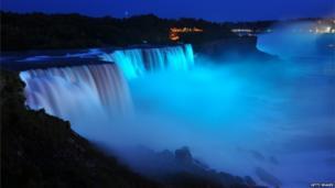 Niagara Falls lit up with blue lights