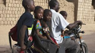 A family on a motorbike in Timbuktu, Mali - Thursday 25 July 2013