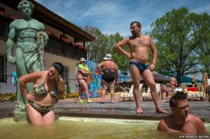 People rest in the thermal hot springs in Kosino, Ukraine