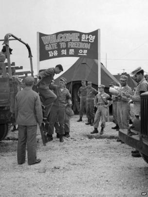 """Billy J. Buchanan of Atlanta, Georgia, arrives at UN POW exchange point, Panmunjom, Korea, 6 August 1953, on second day of """"Operation Big Switch."""""""