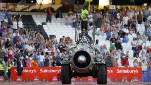 Usain Bolt being driven around the stadium on a rocket