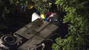 Wreckage and rescue workers in the ravine near Avellino (29 July)