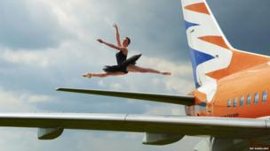 Ballerina Susie King on the wing of a plane at Cotswold Airport