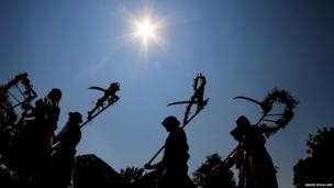People take part in a parade during the traditional harvest festival in Straznice