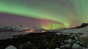 A vast sweep of shimmering auroral light