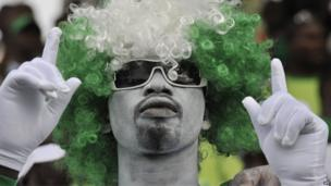 A Nigerian supporter attends the 2014 African Nations Championship (CHAN) qualifying football match between Ivory Coast and Nigeria on 27 July 2013 at the Robert-Champroux Stadium in Abidjan. Ivory Coast defeated Nigeria 2 - 0.