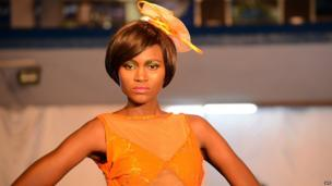 A model parades on the catwalk in Kinshasa in the Democratic Republic of Congo on 26 July 2013