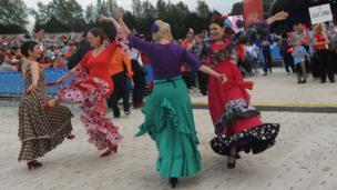 Dancers in international costumes
