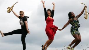 Jazz musicians jumping in the air in Edinburgh.