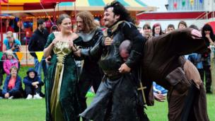 Maid Marian is taken by the Sheriff's men during 29th annual Robin Hood Festival