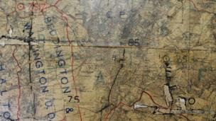 An old map of London on the wall in the 4th operations room