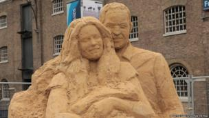 Sand sculpture of the Duke and Duchess of Cambridge with the baby prince