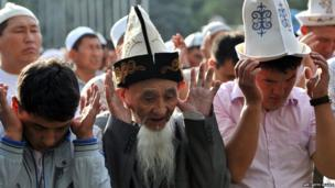 Kyrgyz Muslims pray on the first day of Eid al-Fitr at a square in central Bishkek (8 August 2013).