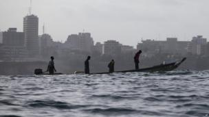 A Senegalese fishing boat heads out to sea off Dakar, Tuesday 6 August 2013
