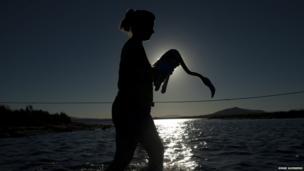 woman carrying flamingo