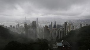 The clouds are hanging low over the city of Hong Kong, seen from the Victoria Peak, in Hong Kong Tuesday, 13 August 2013