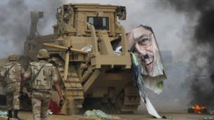 A poster of deposed Egyptian President Mohammed Morsi lies on a bulldozer around Cairo University and Nahdet Misr Square as security forces move against camps occupied by supporters of deposed President Mohammed Morsi 14 August 2013