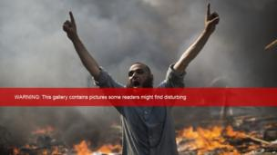 A supporter of ousted Islamist President Mohammed Morsi shouts during clashes with Egyptian security forces in Cairo's Nasr City district, Egypt, Wednesday, Aug 14, 2013