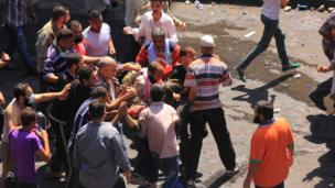 Wounded protester carried to ambulance. 14 Aug 2013