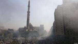 Smoke rises near Al-Fath Mosque during clashes at Ramses Square in Cairo 16 August, 2013.