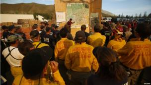 Fire crews attend a planning meeting for the Beaver Creek wildfire outside Hailey, Idaho 16 August 2013