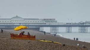A life guard stationed on a deserted Brighton beach