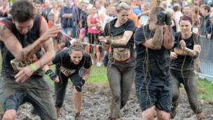 Tough Mudder competitors covered in mud