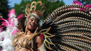 A woman taking part in a carnival procession