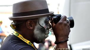 A performer takes a photo. Photo: Justin Spencer