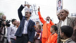 NDC member Baraa Shaiban attends a rally outside the American embassy in Sanaa alongside both relatives of Yemeni prisoners at Guantanamo Bay, in Cuba, and citizens killed by US drone strikes in Yemen