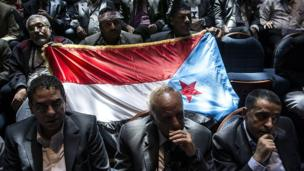 NDC members hold up the flag of the former People's Democratic Republic of Yemen, which is now synonymous with the Southern Movement, a coalition of groups seeking either social and political parity with – or outright secession from – Yemen's north